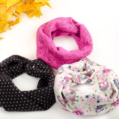 These pink themed baby scarves are meant to fit from 6 months to toddler